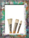 Frame with paintbrushes royalty free stock images