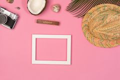 Frame, palm leaf, hat,  on a pink background. Top view stock photos