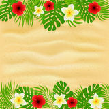 Frame of palm leaves and flowers on sandy background Royalty Free Stock Photos