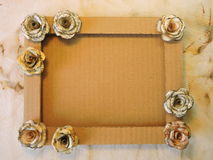 Frame with paper roses Stock Photo
