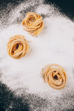 Frame of pasta on scattered flour Royalty Free Stock Photography