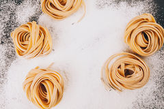 Frame of pasta on scattered flour Stock Image