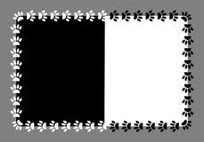 Frame paw prints dog on black and white Stock Image