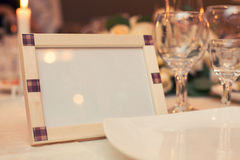 Frame for the photo of beige color. On a holiday table stock image