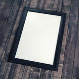 Frame of photo. Blank frame of photo frame on wooden background royalty free stock image