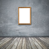 Frame of photo on grunge wall inside the room. Stock Photography