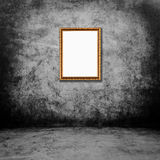 Frame of photo on grunge wall inside the room. Stock Images