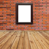 Frame photo on red brick wall and wood perspective. Royalty Free Stock Photography