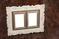 Frame 11. Frame for photos against a brown floor Royalty Free Stock Images