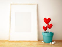 Frame picture and flower pot. On wood floor Royalty Free Stock Photography
