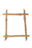 The frame for the picture made from rough pine logs, isolated on royalty free stock images
