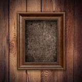 Frame picture vintage with grunge on wood background Stock Images