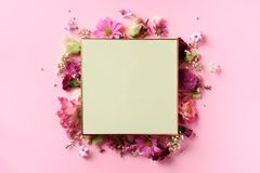Frame of pink flowers over punchy pastel background. Valentines day, Woman day concept. Spring or summer banner with copy space.  stock images