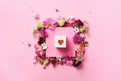 Frame of pink flowers over punchy pastel background. Valentines day, Woman day concept. Spring or summer banner with copy space.  royalty free stock image