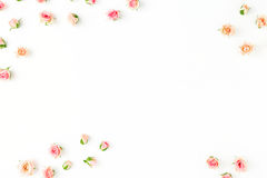 Frame of pink roses on a white background. Flat lay Royalty Free Stock Photography