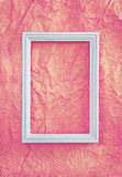 Frame on pink wrinkled paper Royalty Free Stock Images