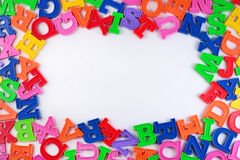 Frame of plastic colorful alphabet letters on a white Royalty Free Stock Photography
