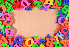 Frame of plastic colorful alphabet letters Royalty Free Stock Photo