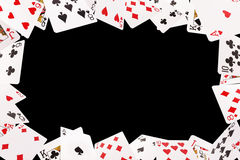 Frame of playing cards on a black background royalty free stock image