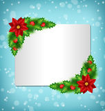 Frame with poinsettia, holly and pine on blue. Blank frame with flower of poinsettia, holly sprigs and pine branches in snowfall on blue background Stock Images