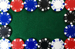 Frame of poker chips on green background Royalty Free Stock Image