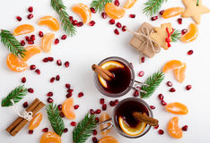 Frame of pomegranate seeds, mandarines and twigs tree with two royalty free stock image