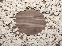 Frame of popcorn on wooden background Royalty Free Stock Photo