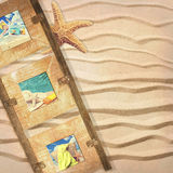 Frame With Postcards. Wooden frame with summer postcards on sandy background with starfish Royalty Free Stock Photos