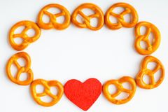 Frame of pretzels and red heart white background Royalty Free Stock Photos