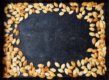 Frame with pumpkin seeds Stock Photography