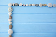 Frame of pure smooth stones on a wooden background Royalty Free Stock Photography