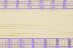 Frame of purple ribbon on wooden background Royalty Free Stock Photo