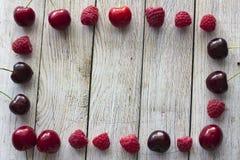 Frame of raspberries and cherries Stock Image