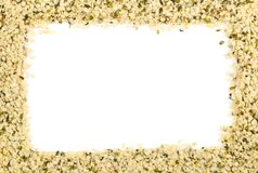 Frame of raw, organic hemp seeds over white with copy space royalty free stock photo