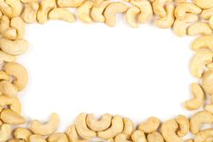 Frame of raw, organic, whole cashew nut kernels over white Royalty Free Stock Photo