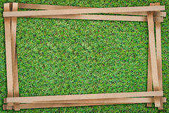 Frame of recycle paper cut with free copy space on green grass Royalty Free Stock Image