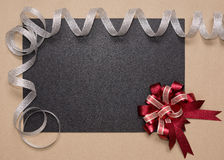 Frame with red bow and silver ribbon Royalty Free Stock Image