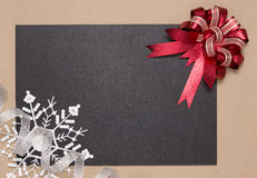 Frame with red bow and snowflake Royalty Free Stock Photography