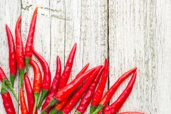 Frame of red Chile pepper on white wooden table.  stock photo