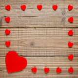 Frame of red hearts on wood Royalty Free Stock Photo