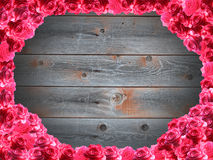 Frame from red roses and the boards Royalty Free Stock Images