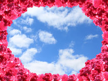 Frame from red roses and cloudy sky Stock Photography