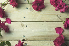 Frame of red roses wooden background Stock Photography