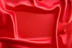 Frame on red satin. Background Stock Image