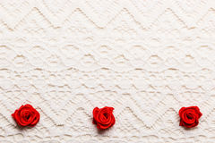 Frame of red silk roses on lace Stock Photos