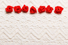 Frame of red silk roses on lace Stock Photo