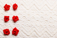 Frame of red silk roses on lace Stock Photography