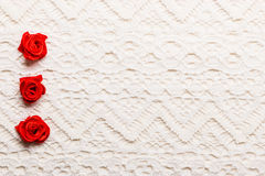 Frame of red silk roses on lace Royalty Free Stock Photo