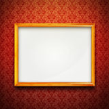 Frame on red vintage wallpaper. Gold frame on red vintage victorian wallpaper Royalty Free Stock Photography