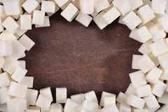 Frame of refined sugar. On a wooden background Stock Image